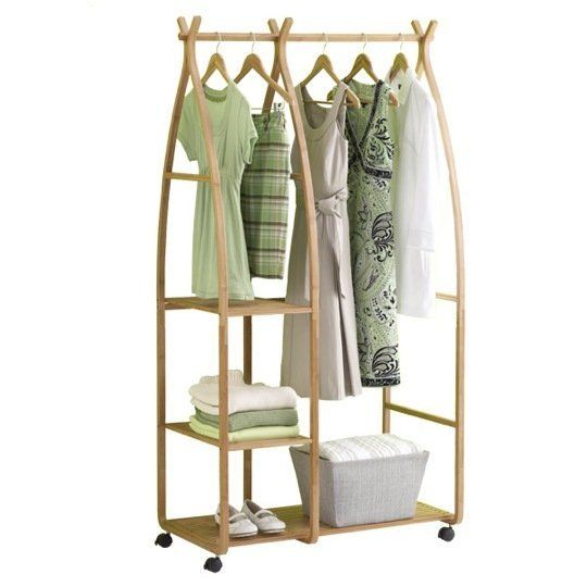 Bamboo garment rack at the container store garment racks for Furniture to hang clothes