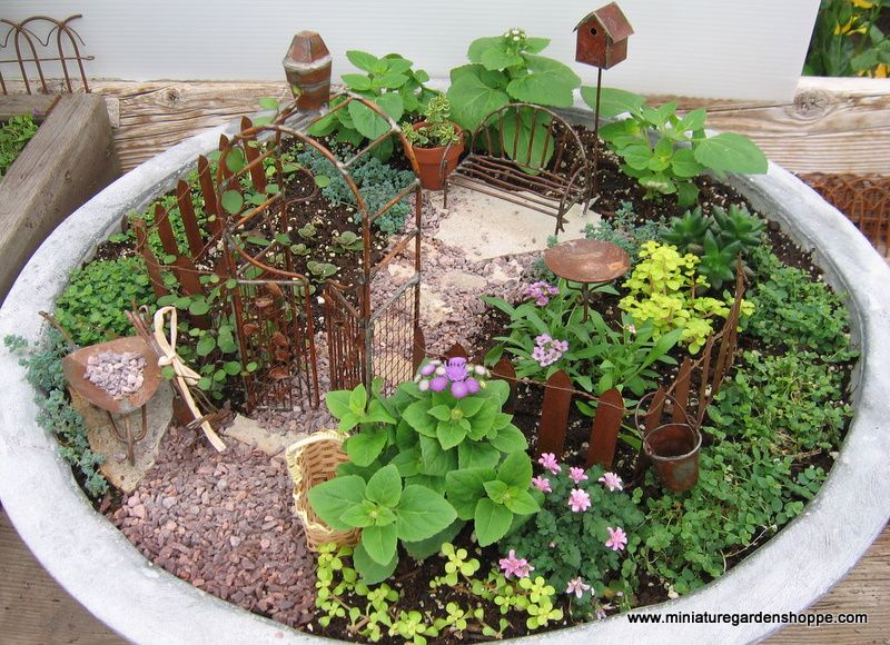 Miniature Gardening Ideas | Decorate for the holidays. Little colored eggs and a bunny statue get ...