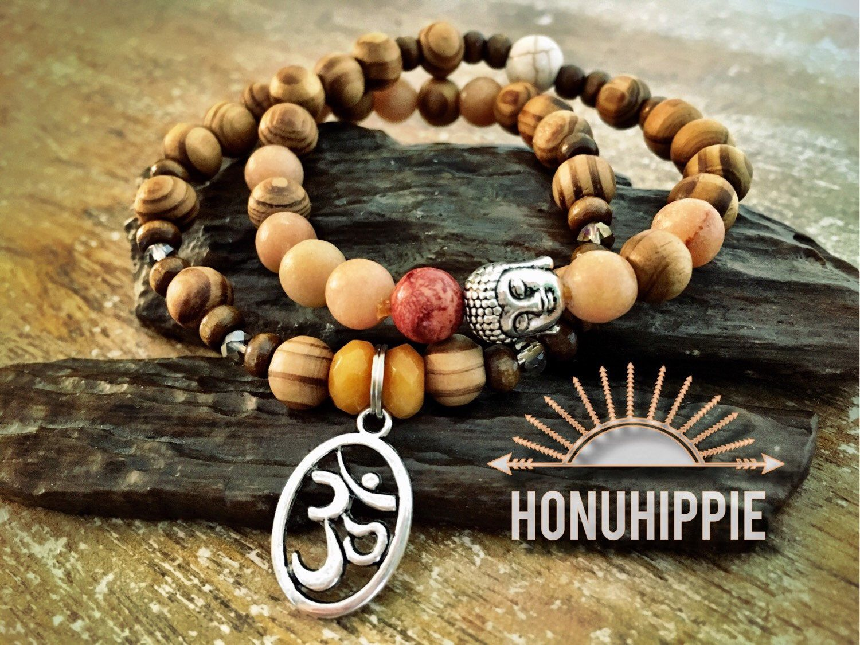 """Buddha """"Om"""" symbol cuff bracelet set, boho yoga mala jewelry by HonuHippie on Etsy https://www.etsy.com/listing/268827348/buddha-om-symbol-cuff-bracelet-set-boho"""