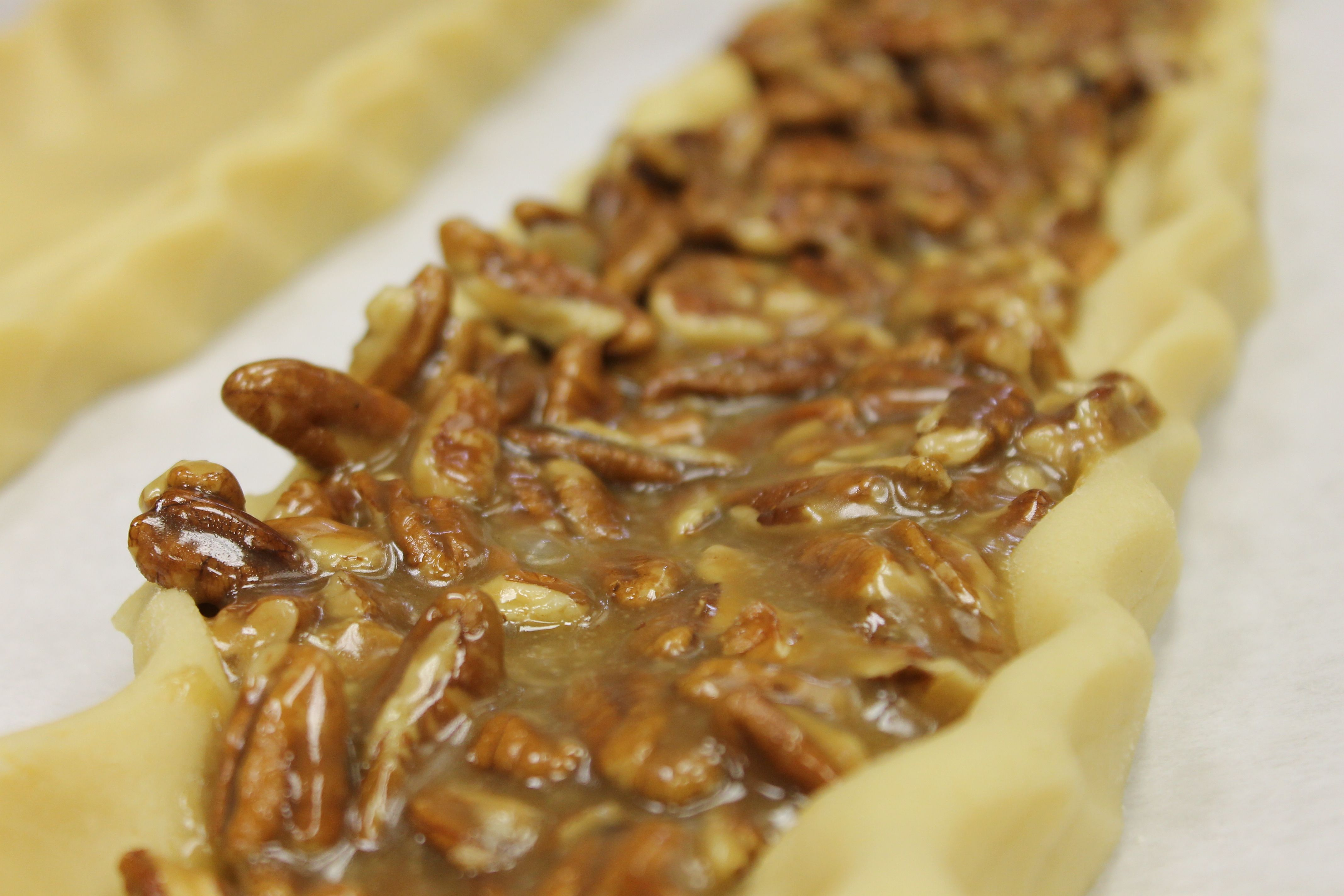 Baking up our pecan wedges just in time for National Nut Day! #carlosbakery