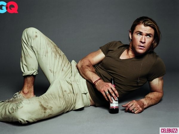 Chris Hemsworth gets down and dirty for his July spread in GQ magazine