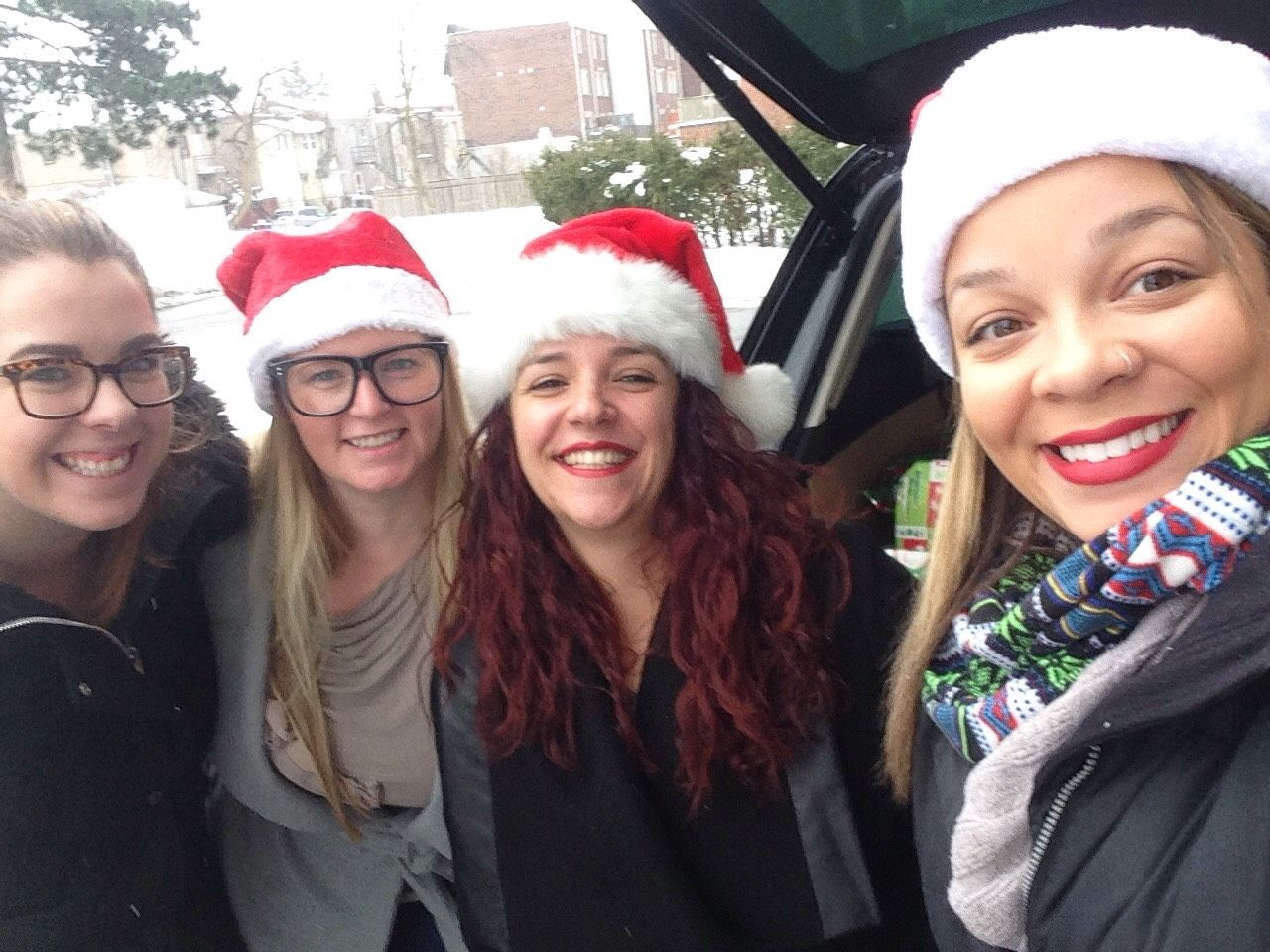 Here's TechWyse's very own and beautiful Angela, Britt, Raquel and Siobhan doing their part as Santa's little helpers!