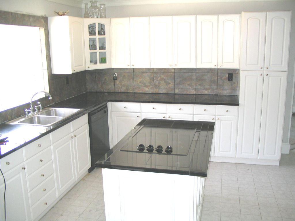 New black granite counter tops and ceramic tile back splash ...