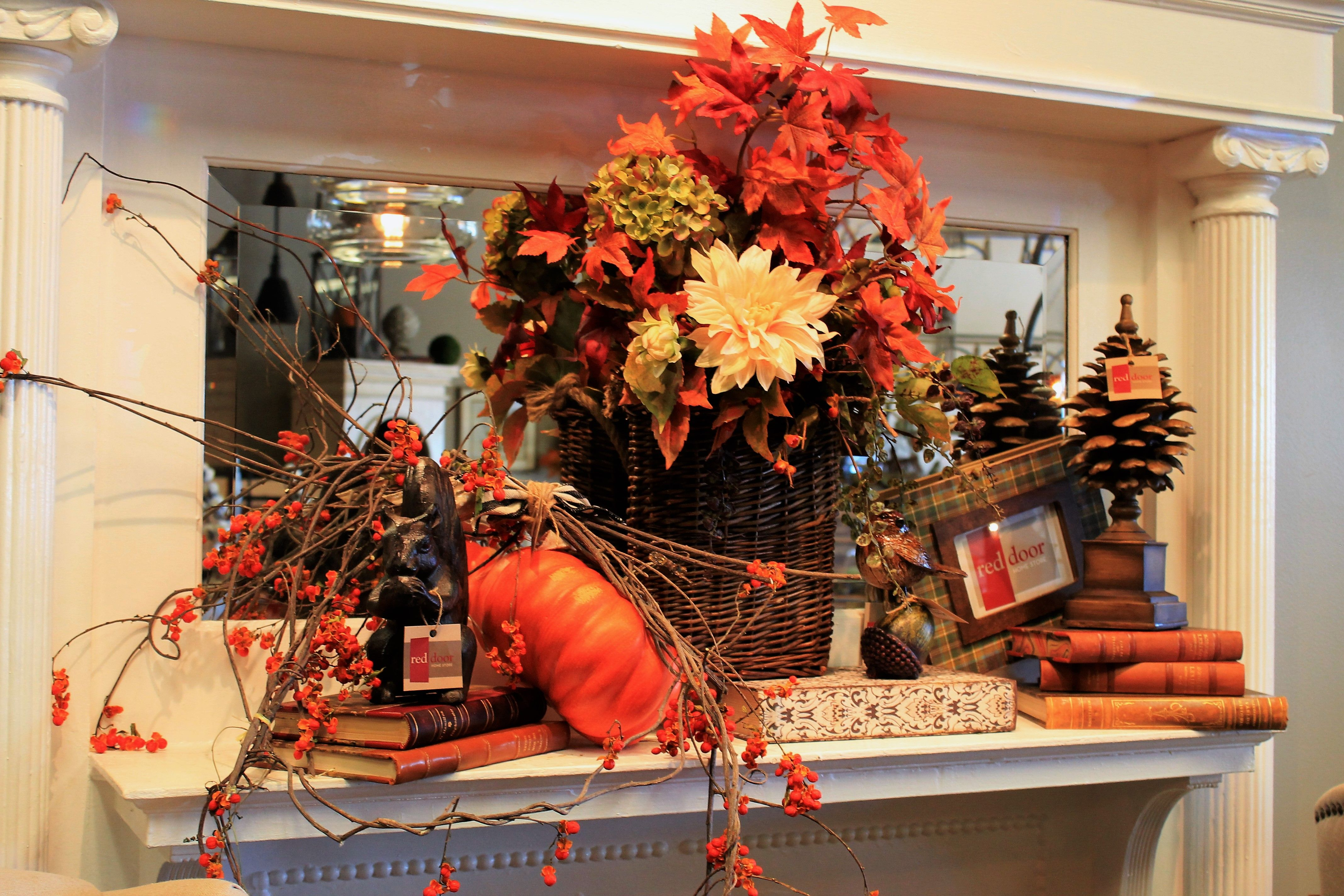 Love the books on the mantel with the Autumn naturals -- from Red Door Home STore