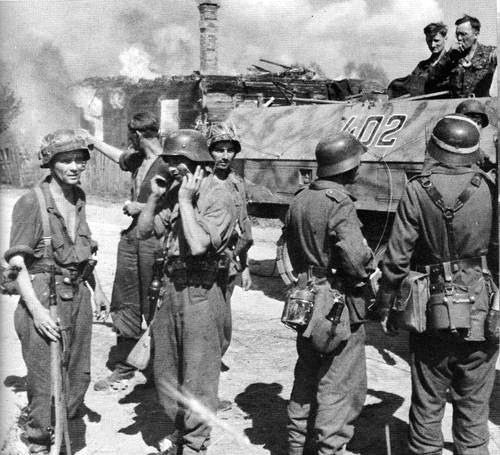 Near Kowel, Russia 1944. The 5th SS-Panzer-Division 'Wiking' struggles to stop the Red Army. 12th company of the regiment 'Germania' prepares for a counter attack. | by GLORY. The largest archive of german WWII images