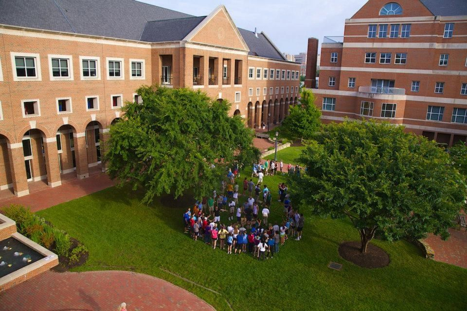 Mac students in front of the kenanflagler business school