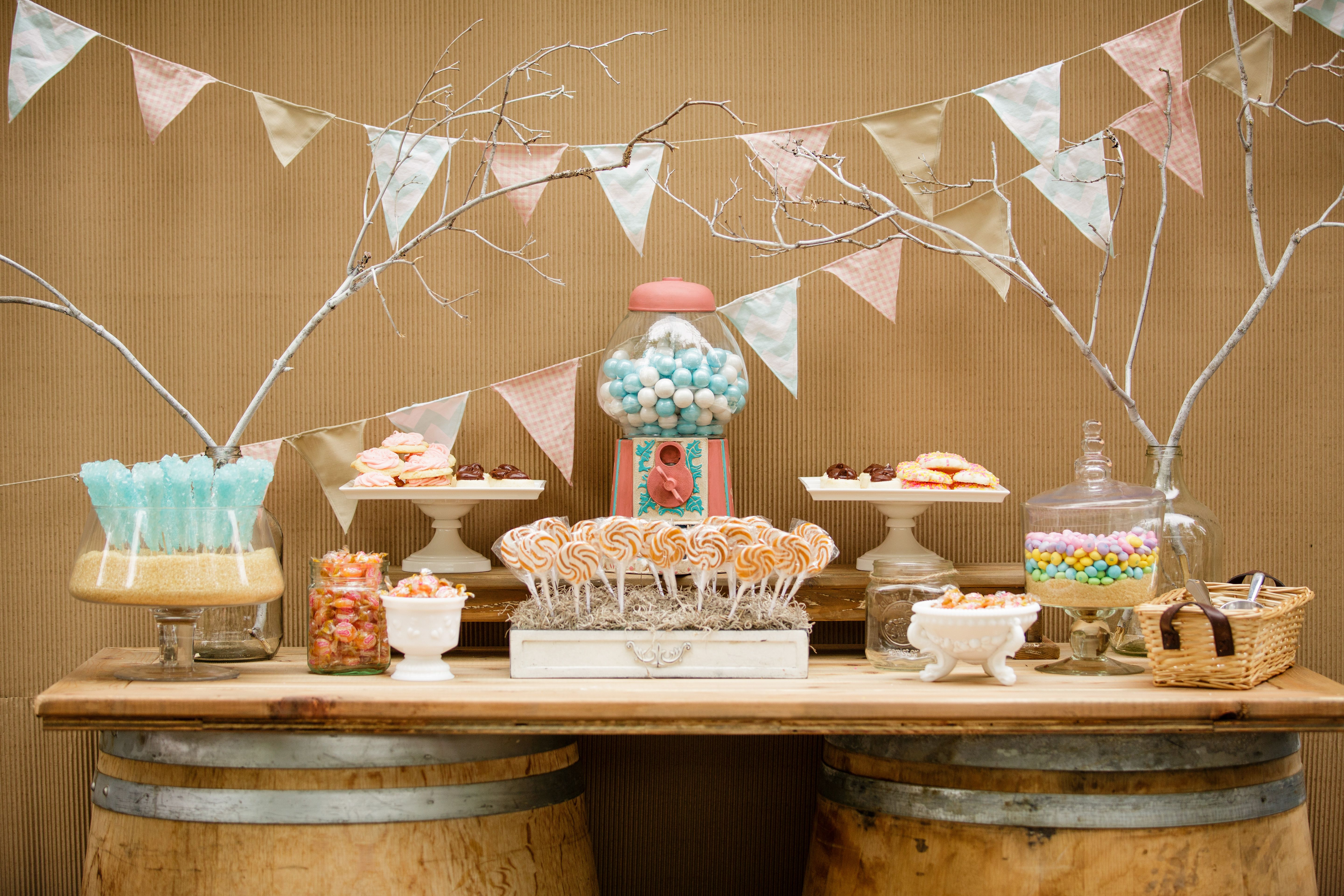 Candy table with a custom gumball machine decorative flags all in