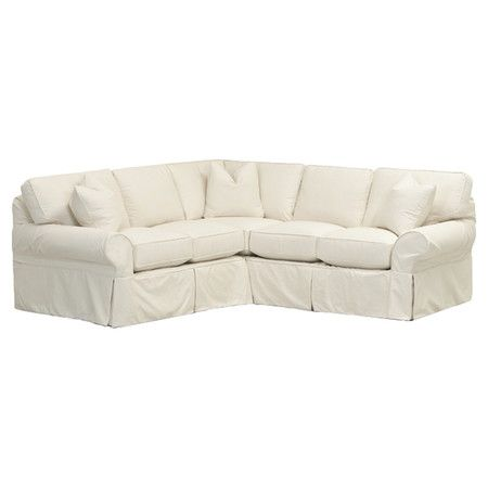 Showcasing Gently Curved Arms And Slipcover Style Upholstery, This Classic Sectional  Sofa Offers Timeless