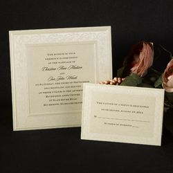 Winter wedding invitations featuring a gold shimmer paper embossed
