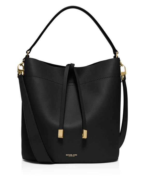 0e2da6dbb969 A relaxed silhouette rendered in sumptuous leather with suede lining, this Michael  Kors Collection shoulder bag is equal parts cool and refined.