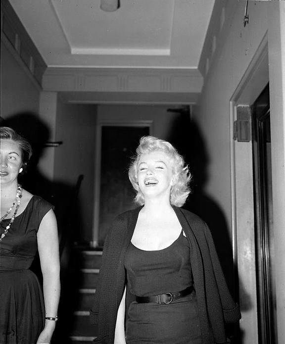Marilyn during a press interview outside her Sutton Place apartment, NYC, about her engagement to Arthur Miller, June 21, 1956.