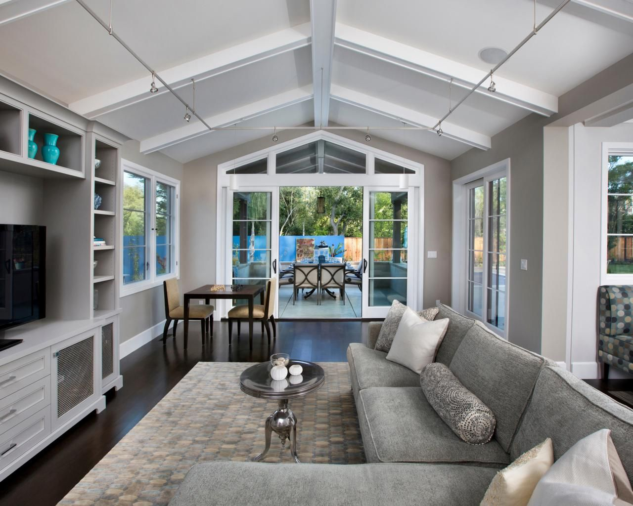 This Light Gray Family Room Features Dark Hardwood Floors And