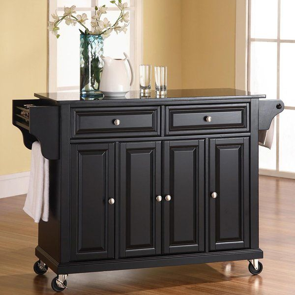 Entertain and organize in classic style with this essential kitchen island, perfect for any hostess or homemaker with an eye for timeless design. Featuring a four-point castered base, this design doubles as a prep station and bar cart. Use its granite top in the kitchen to chop tomatoes and French bread for tonight's crispy bruschetta appetizer, then roll it out into the living room to serve up trays of hors d'oeuvres and expertly crafted cocktails to party guests. Featuring two deep ...