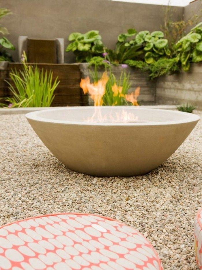 gartenideen ausgefallene feuerstelle kies pflanzen - eine feuerstelle am pool