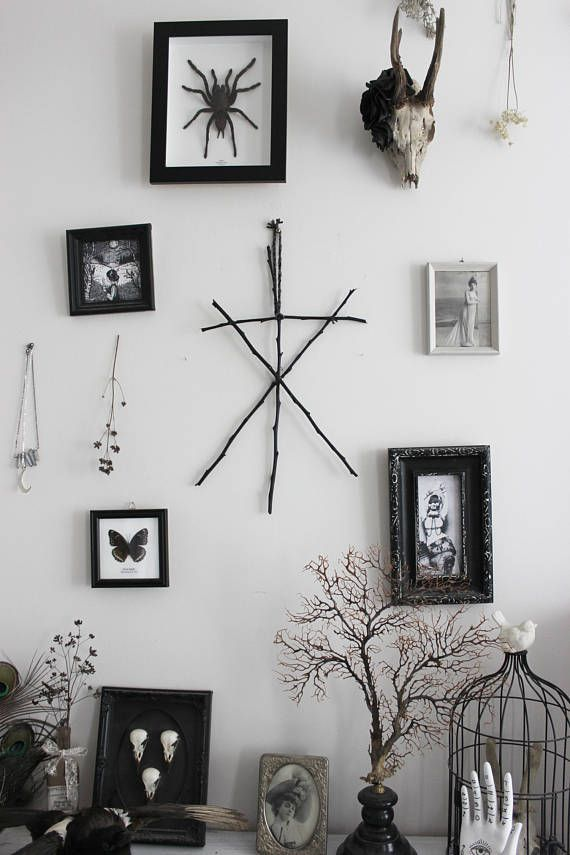 Photo of Call of the Witch Black. pagan viking witchcraft rune inspired wall hanging black twigs and wool .