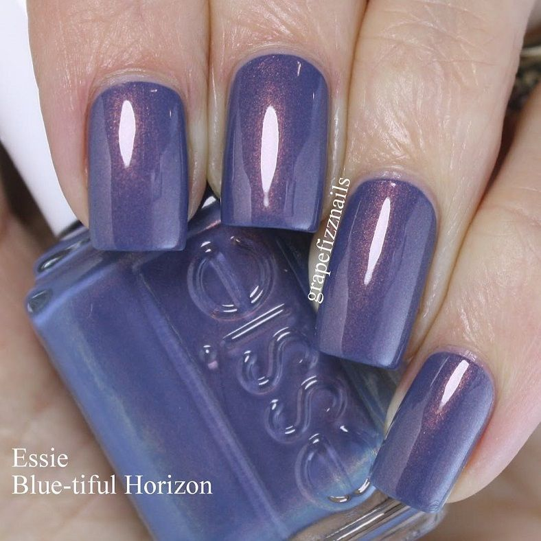 Dusty blue cream with orange-copper shimmer