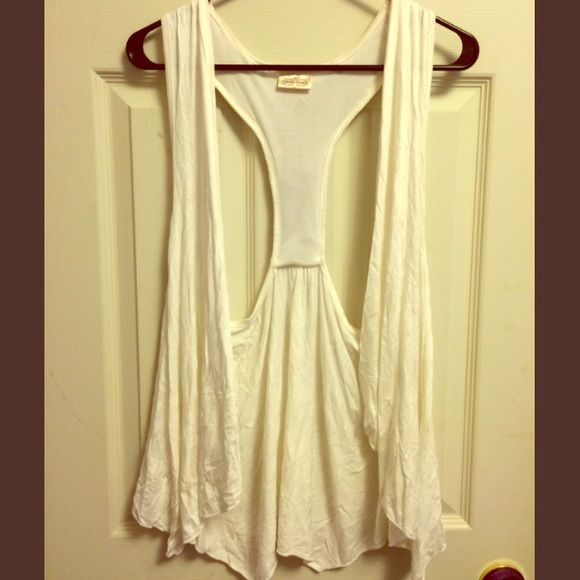 White Beaded Vest Adorable white beaded vest, worn a few times over shirts. From dye on another shirt, has light red smudges on inside of shoulders, not visible when worn. Beads are detached in one place shown, but is in easy fix. Pretty Good Jackets & Coats Vests