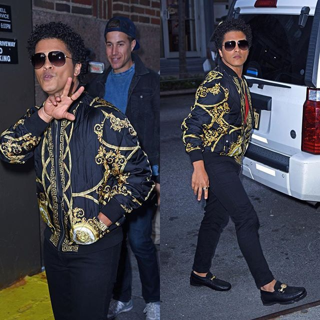 4d4920051b200  BrunoMars turns up the attitude wearing a silk  Versace printed bomber  jacket matched with a pair of Versace black loafers with gold hardware.