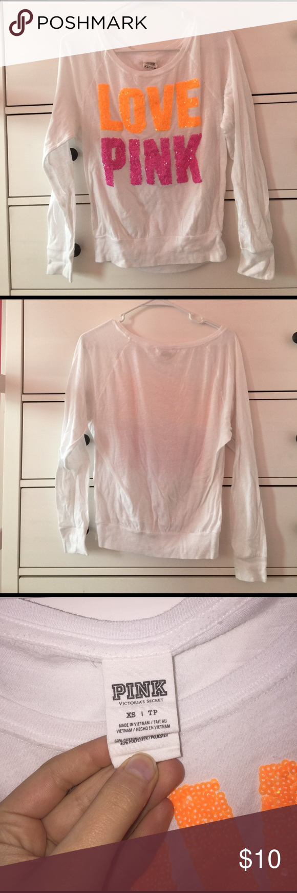"Pink/Victoria's Secret long sleeve t-shirt Cute white long sleeve shirt with orange and pink sparkles that spell out ""LOVE PINK"". US ONLY!!! PINK Victoria's Secret Tops Tees - Long Sleeve"