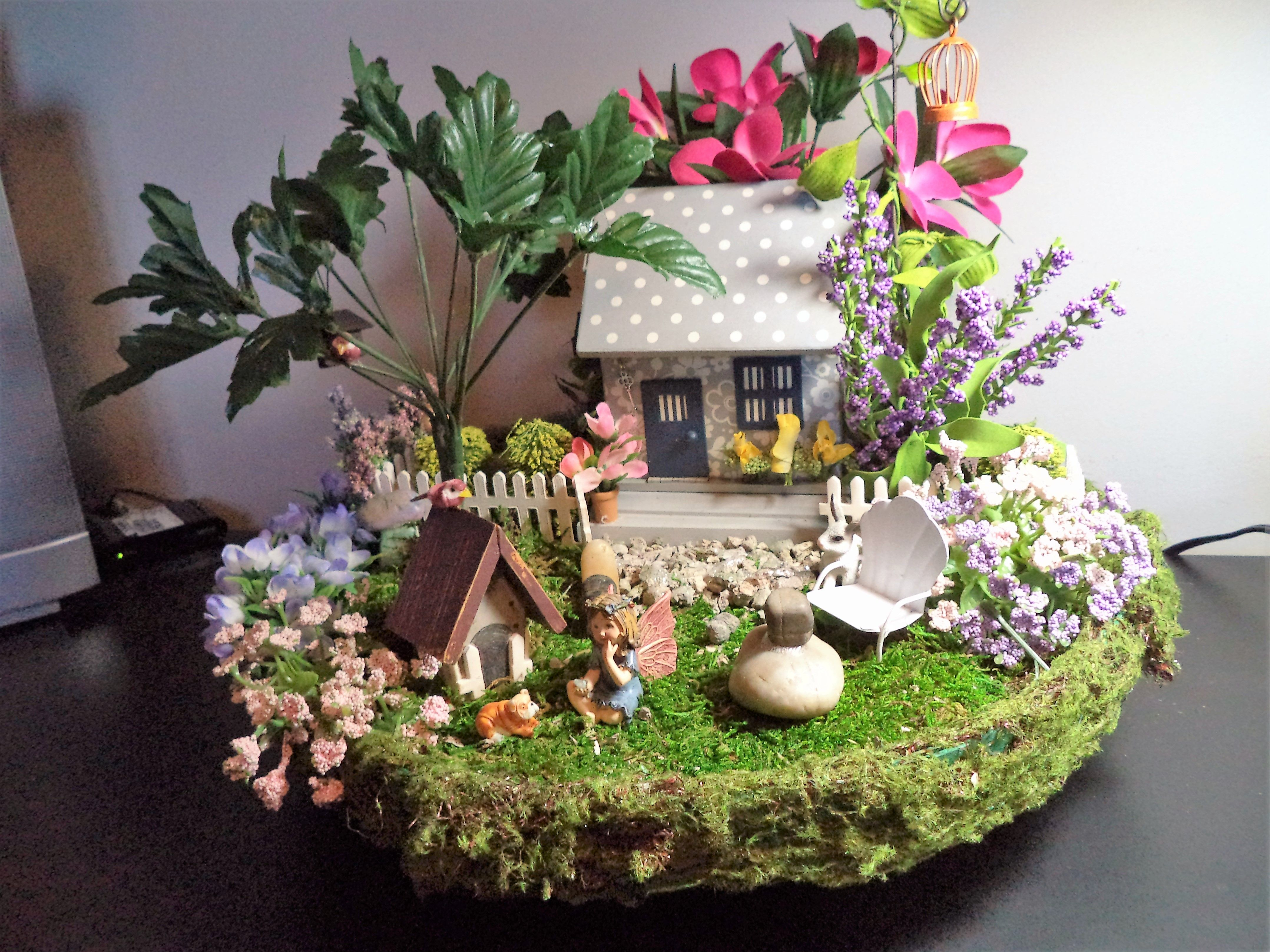 Porch fairy garden.  Fairy playing with her dog.