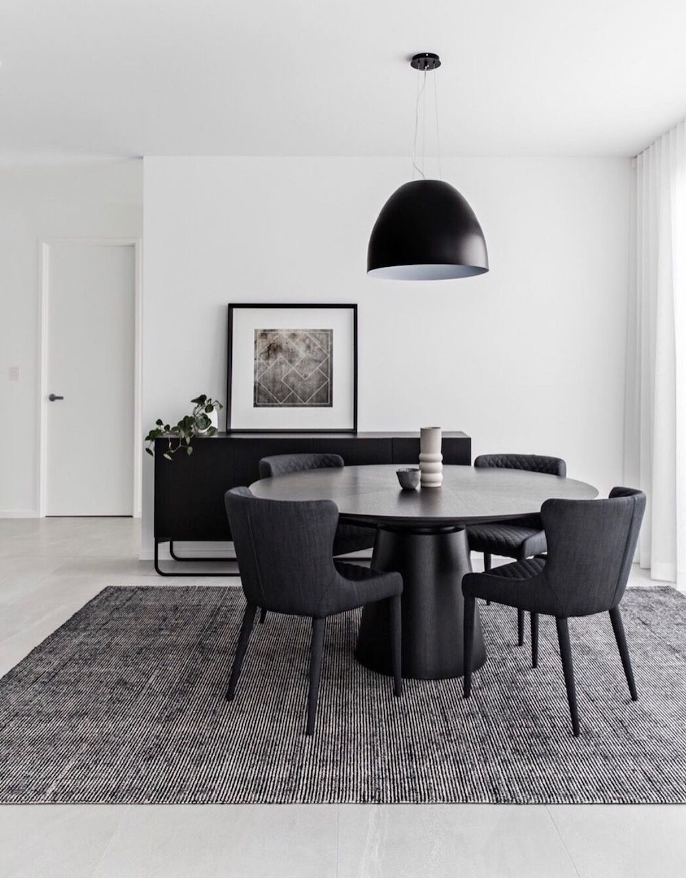 Black Round Dining Table With Black Pendant Light Console And Black Patterned Rug Dinning Tables And Chairs Round Dining Table Dining Table