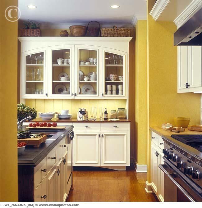 dark yellow walls off white cabinets- this is the closest ...