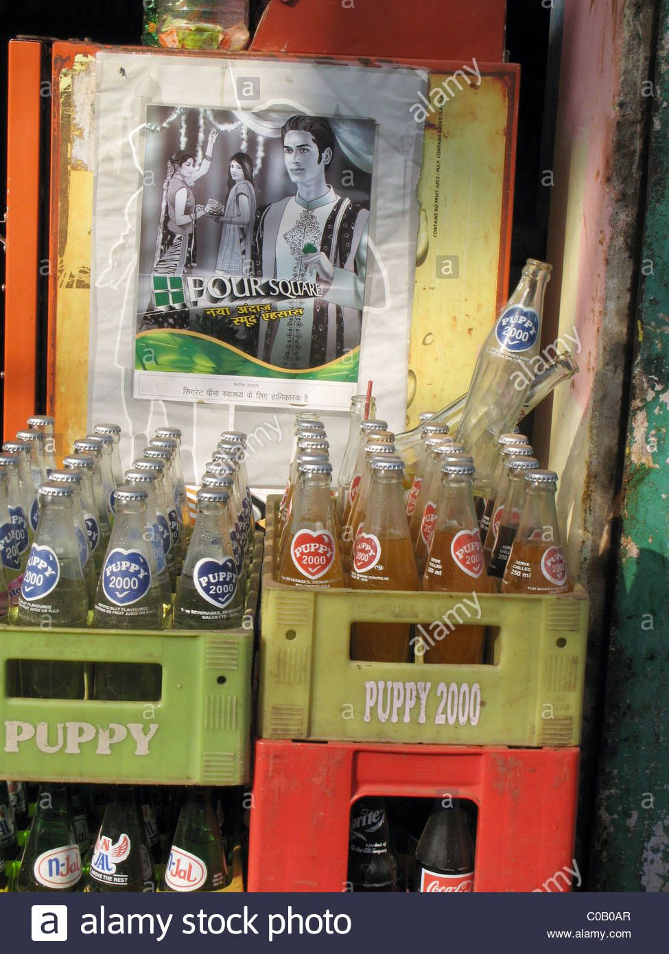 India. Crates Of Empty Soft Drink Bottles And Advertising Poster In Stock Photo, Royalty Free Image: 34662511 - Alamy