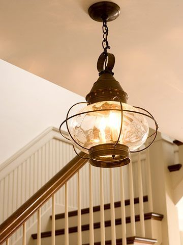 House Tours: Cottage by the Sea Boat-Style Light Light fixtures reminiscent of a bygone era give this newer house character. The reproduction cast-iron light in the foyer is similar to a boat lantern. Tours: Cottage by the Sea Boat-Style Light  Light fixtures reminiscent of a bygone era give this newer house character. The reproduction cast-iron light in the foyer is similar to a boat lantern.Boat-Style Light  Light fixtures reminiscent of a bygone era give this newer house character. The reproduction cast-iron light in the foyer is similar to ...