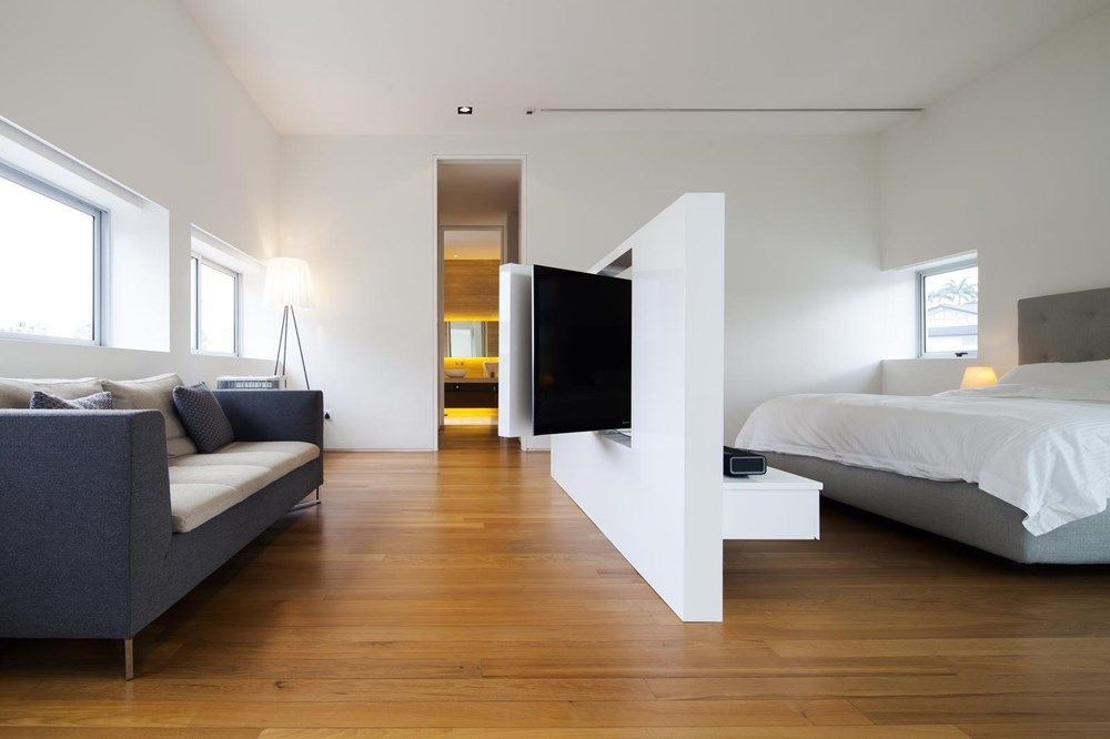 Rotating Tv Panel Design Allows Watching Shoes From The Bed Or The