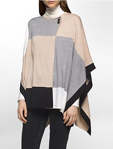 a poncho featuring textured colorblock fabric, an wrap front design, a turn-lock closure and ribbed knit detailing for effortless style.
