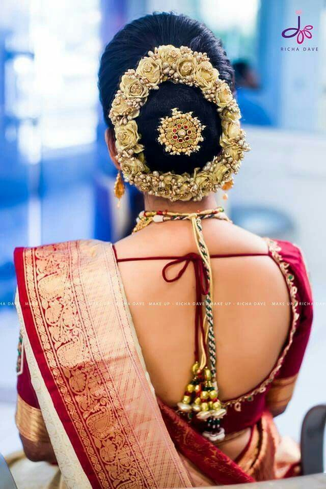 What A Beautiful Large Low Bun With Gajra Juda Pin Care However Should Be Taken Before Adopting Such H Bridal Hair Buns Bridal Hairdo Indian Bride Hairstyle