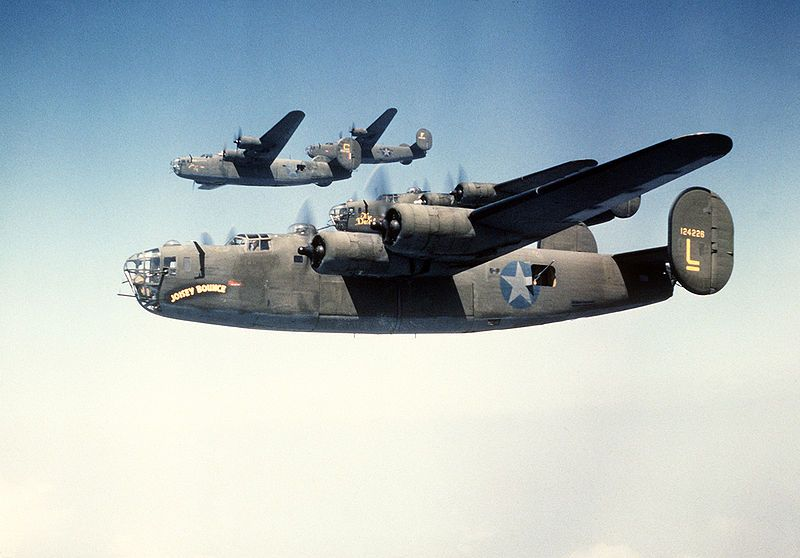 """93rd Bomb Group formation flight. Near aircraft is Consolidated B-24D-25-CO (S/N 41-24226) """"Joisey Bounce"""" and second aircraft is (S/N 41-24..."""