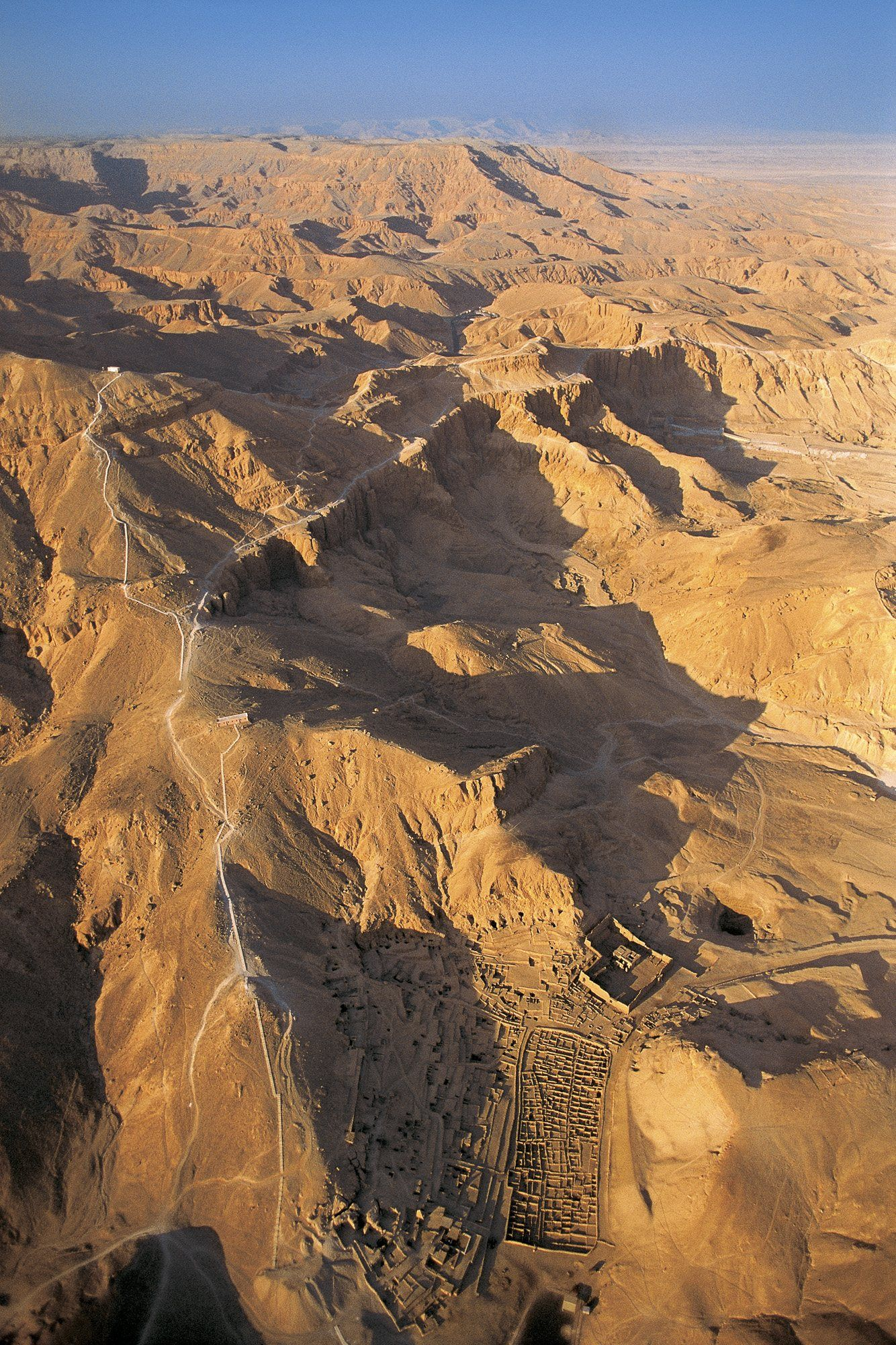 Deir el-Medina, from above   The picture features an overhead view of Deir el-Medina, surrounded by the rugged Theban mountains. To the left of the settlement may be the necropolis of workers.