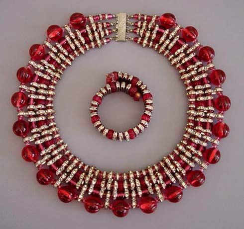 """HASKELL cranberry glass beads in four sizes (melon, round and disk shaped) and clear rhinestone bars comprise this 15"""" by 1-1/2"""" collar necklace and 7"""" by 3/4"""" coil bracelet with safety chain. I would love to own this!"""