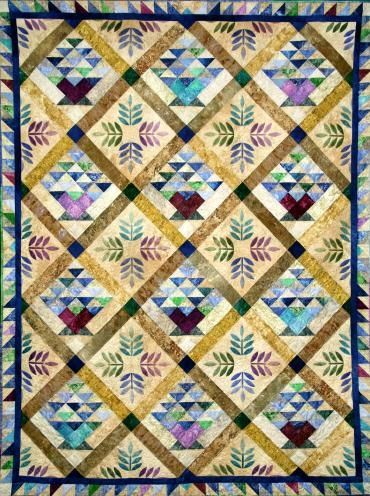 """This beautiful design, by Chris Hoover of Whirligig Designs, features Stonehenge fabrics and pre-cut Stonehenge Strip sets from Northcott. The finished quilt measures 57"""" x 74"""". Quilt Kit available at www.homespunhearth.com"""