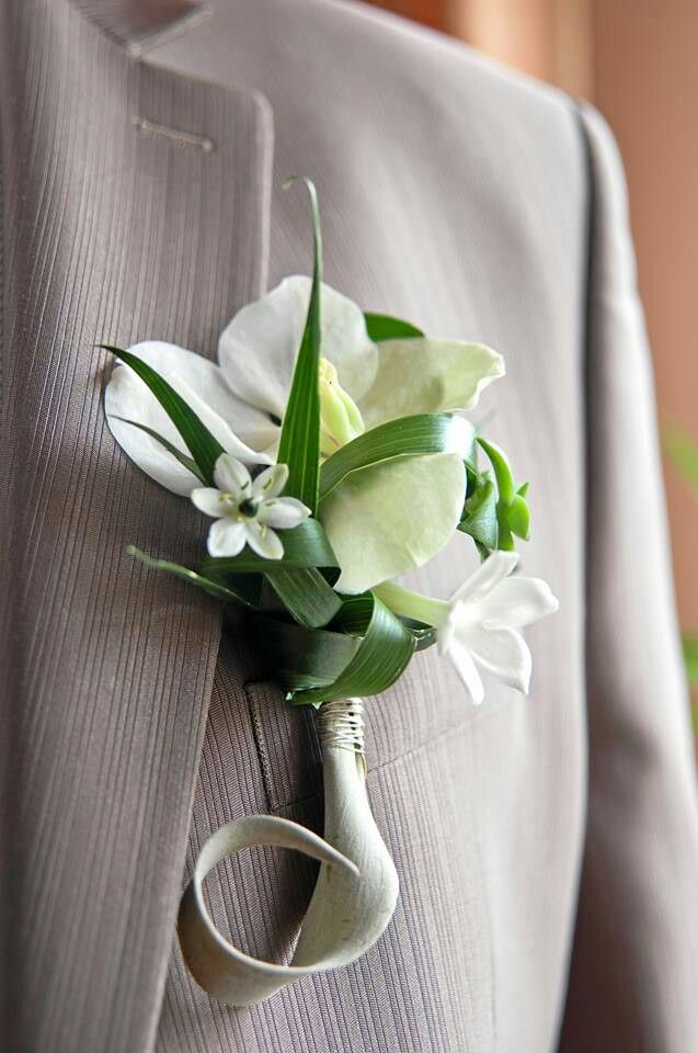 A delicate buttonhole; featuring a Phalaenopsis orchid, Stephanotis and chincherinchee.