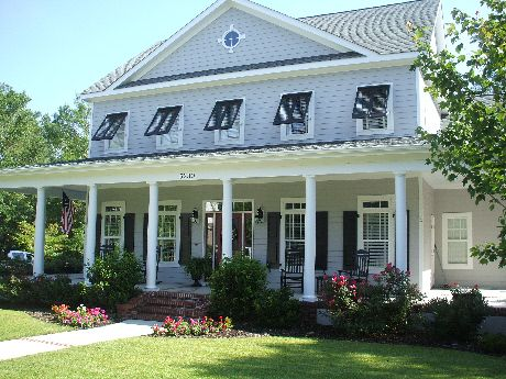 Gorgeous Farmhouse Outfitted With Bahama Shutters Bahama Shutters Cottage Style Homes House Front Design