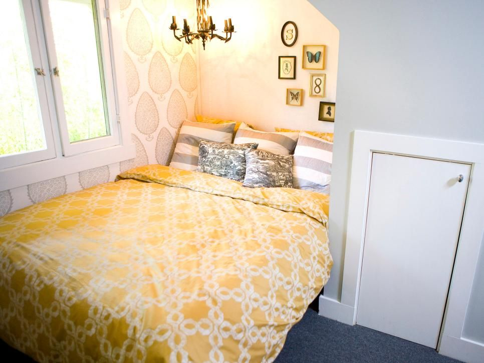 White and grey walls, a cheery yellow duvet and a bright chandelier ...