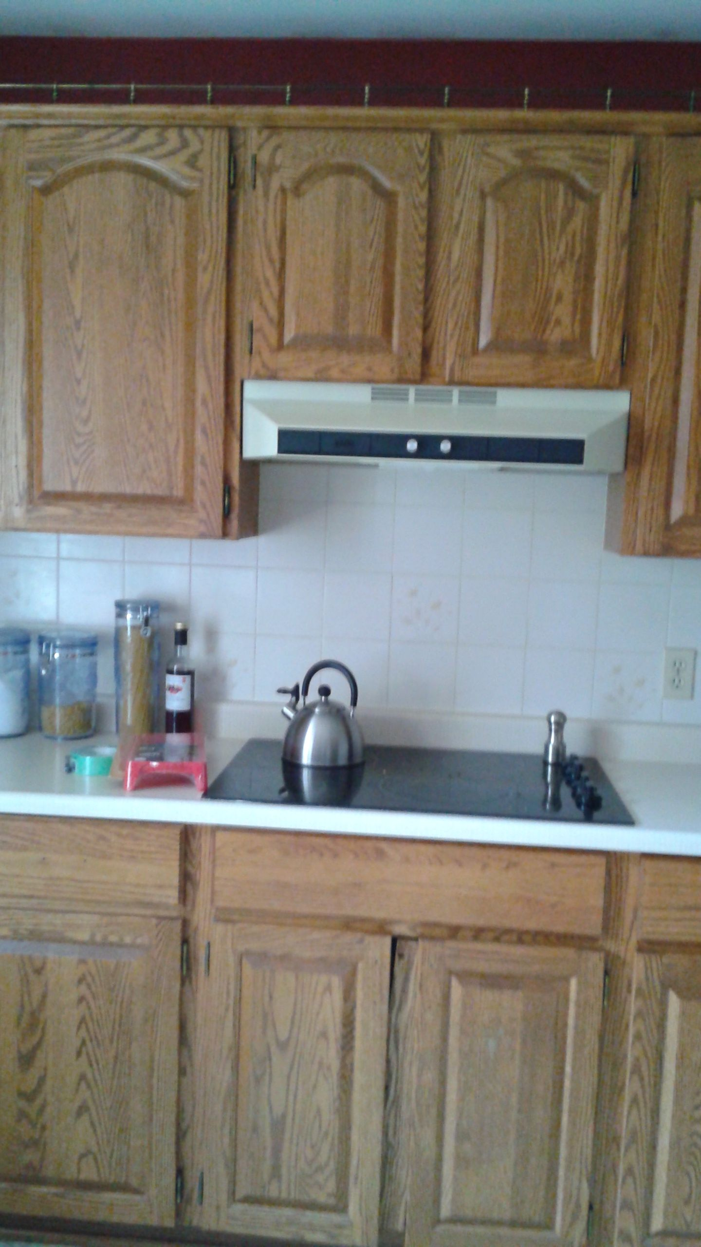 Kitchen Reno On A Budget 1980 S Oak Cupboard S I Primed Everything Cabinets Ceramic Tiles Countertops With S Kitchen Decor Painting Oak Cabinets Kitchen