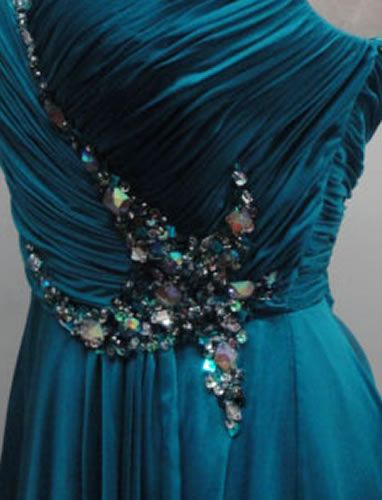 dress embellishment - I don't usually go for this kind of glitz, but I do like the shape of it. Could be fun if made in a different material from the dress.