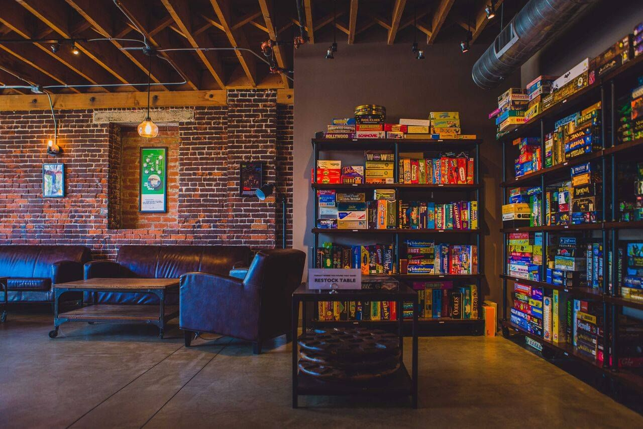 Pin By Skylar Hoscheit On Home Ideas Game Cafe Board Game Cafe Board Game Room