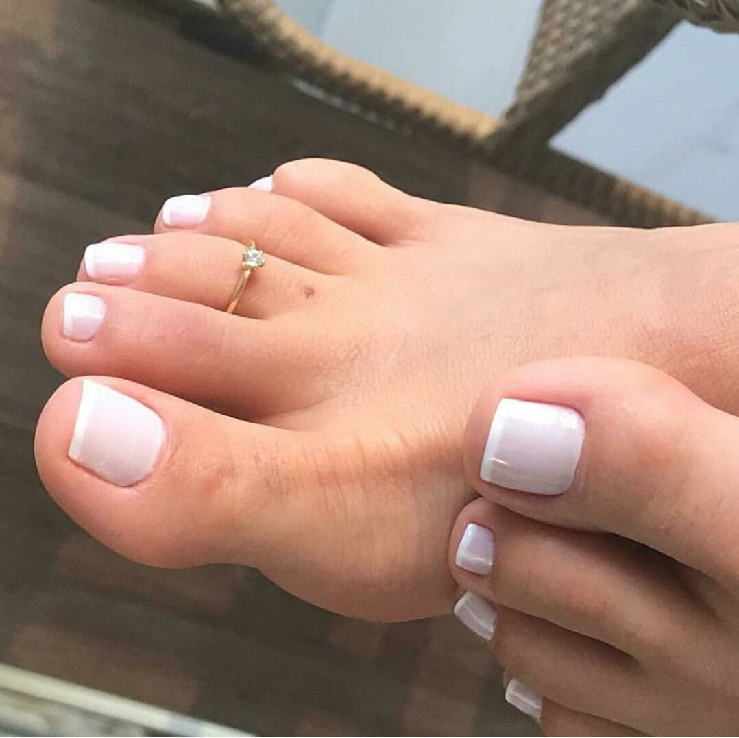 Girl With Perfect Feet And Red Toes Shows Her Feet And Soles
