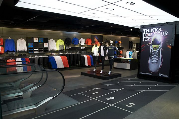 Sports store retail design shop interior sports display nike town london vm sport Interior design stores london