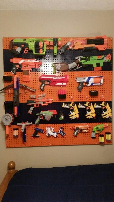 Nerf Gun Storage Board. We painted and mounted peg board to store all of  Rowan's