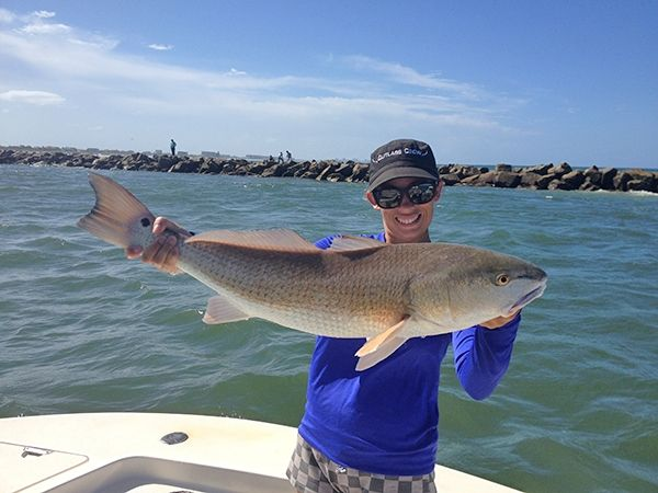 Capt dan prochak anna bringing in a bull redfish caught for Ponce inlet fishing