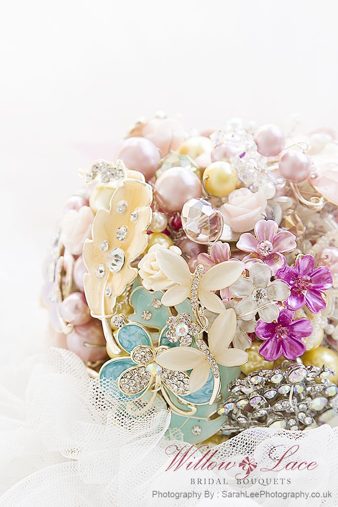 Fantasia brooch bouquet, stunning pastel enamel brooches designed in all pinks,golds,and lilacs..