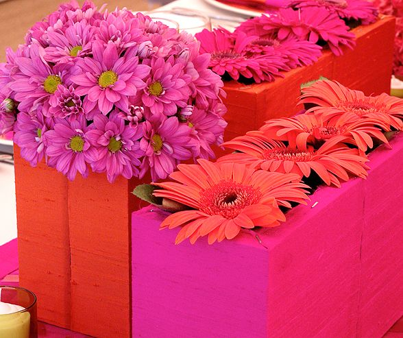 Boxes Covered In Orange And Pink Silk Are Filled With Daisy