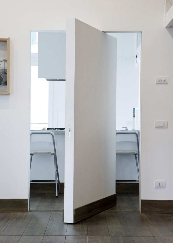 pivot door and wall at the same time
