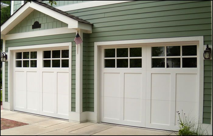 why cheap garage door is really costing you garage With cheap carriage garage doors