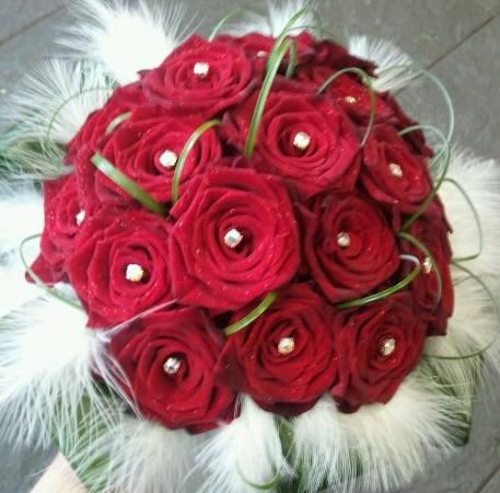 red roses with diamond centers and feathers